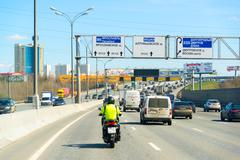 Moscow, Russia -  April 08.2016. Motorcyclist in the left lane on Moscow Ring - stock photo