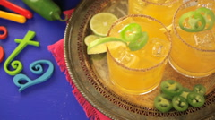 Spicy grapefruit margarita cocktail garnished with lime and jalapenos. Stock Footage
