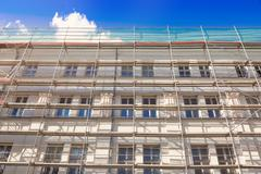 house exterior with scaffold - old town building facade restoration - stock photo
