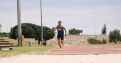 Sportsman doing long jump - stock footage