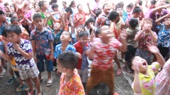 Celebrating Songkran (Thai new year / water festival) children are happy Stock Footage