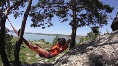 Man relaxing on the hammock in a beautiful day Stock Footage