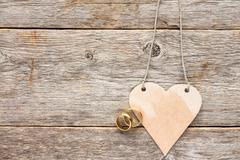 Gold wedding rings and paper heart Stock Photos
