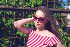 Beautiful girl in a bright red T-shirt, fashion lifestyle, posing against the Kuvituskuvat