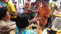 Celebrating Songkran (Thai new year) student Saluting adults teacher Stock Footage