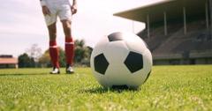 Football player kicking the ball Stock Footage