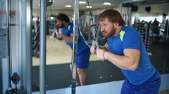 Athletic man doing exercises in a gym - stock footage