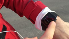 Athlete used his smartwatch then ran on and then the camera turned to the right Stock Footage