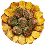 Fried meatballs with rice and French fries - stock photo