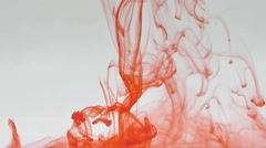 Red ink dropped into water. - stock footage