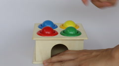 Demonstration of colorful hammer case wooden toy Stock Footage