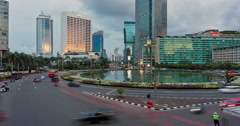 Time lapse of traffic in Jakarta at sunset with zoom out effect Stock Footage