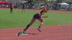 Female Track runner in relay race Stock Footage