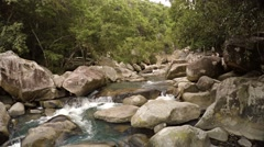 Water Tumbles along a Rocky River Bed in Vietnam, with Sound Stock Footage
