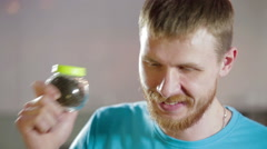 Man plays music shake peppercorn in glass jar Stock Footage
