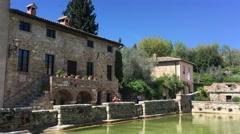 BAGNO VIGNONI, ITALY – APRIL 15, 2016: Bagno Vignoni is a famous thermal spring Stock Footage