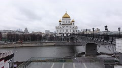 Christ the Saviou church and Patriarshy Bridge, slide shot from opposite bank Stock Footage