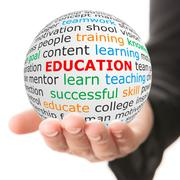 white ball in hand with red inscription education - stock photo