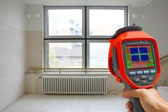 Recording Radiator and a window on a building with Thermal Camera Stock Photos