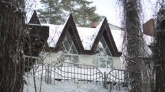 Snow-covered ski resort house in the firry forest Stock Footage