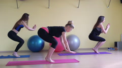 Fitness class and instructor doing yoga exercise in bright room 4k Stock Footage