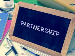 Hand Drawn Partnership Concept on Small Chalkboard - stock illustration