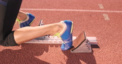 Athlete woman waiting in the starting block Stock Footage