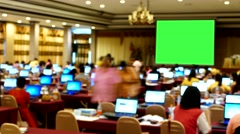 Blank green screen set in front of meeting room. - stock footage