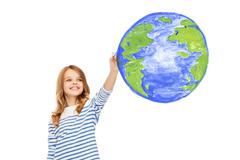 girl drawing planet earth in the air - stock photo