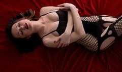 Top view of model posing in black fishnet bodysuit Stock Photos