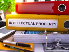 Yellow Office Folder with Inscription Intellectual Property - stock illustration