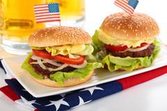 Hamburgers and beer. - stock photo