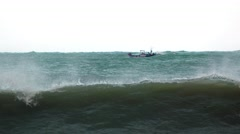 Small Motorized Fishing Boat Braves Rough Seas in Vietnam, with Sound Stock Footage