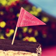 flag-shaped signboard with the text happy mothers day - stock photo