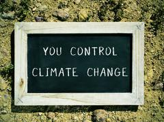 Chalkboard with the text you control climate change Kuvituskuvat