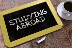 Studying Abroad - Chalkboard with Hand Drawn Text Stock Illustration