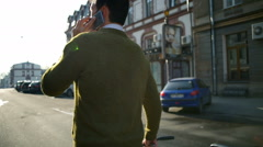 back view man goes next to bicycle and talks on the phone slow motion - stock footage