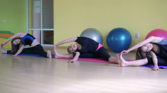 The girls stretching legs sitting on the splits in gym 4k Stock Footage
