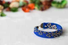 Crochet beaded bracelet with a Oriental pattern close up - stock photo
