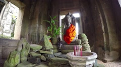 Smoke from incense drifts through ancient hall before altar in Bayon Temple Stock Footage