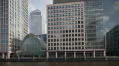 4k docklands canary wharf london finance city money business offices southquay Stock Footage