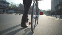 closeup male wearing trousers and classic shoes goes next to bicycle slow motion - stock footage