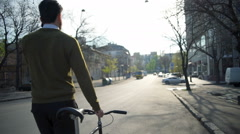 Back view man goes near the bicycle and talks on the phone slow motion Stock Footage