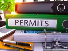 Permits on Green Office Folder. Toned Image - stock illustration
