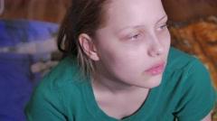 Sad teen girl watching tv, 4K UHD - stock footage