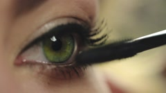 Make up stylist uses mascara for painting lashes - stock footage