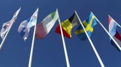 Flags on flagpoles nations of the world against Stock Footage