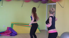 Female group with training doing flexible aerobics in a modern gym 4k - stock footage