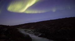 Burning bright aurora northern lights dusk solar flare glacial river Iceland 4k Stock Footage