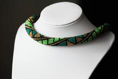 Handmade crochet beaded necklace with geometrical pattern - stock photo